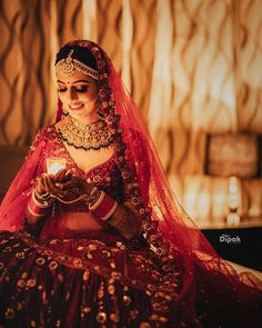 Beautiful bride in a classic red lehenga – girl photoshoot poses Indian Bride Poses, Indian Wedding Poses, Indian Bridal Photos, Indian Wedding Couple Photography, Indian Bridal Outfits, Mehendi Photography, Indian Weddings, Photography Ideas, Indian Wedding Pictures