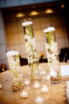 Diy centerpieces 154670568423368107 - cluster of white orchid centerpieces with floating candles Source by hilarytharris White Orchid Centerpiece, White Flower Arrangements, Orchid Centerpieces, Beach Wedding Centerpieces, Wedding Decorations, Centerpiece Ideas, Inexpensive Centerpieces, Wedding Vases, Simple Elegant Centerpieces
