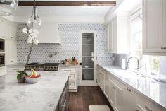 white-marble-countertops-gray-flower-mosaic-tile-backsplash