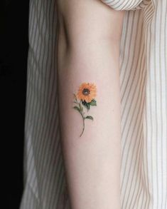 Most women prefer to have sunflower tattoos performed with birds, butterflies, ladybugs and other beautiful creatures. Such kinds of tattoos are usually done to stress the uniqueness of the tattoo its Sunflower Tattoo Meaning, Sunflower Tattoo Shoulder, Sunflower Tattoo Small, Sunflower Tattoos, Sunflower Tattoo Design, Flower Tattoo Designs, Shoulder Tattoo, Watercolor Sunflower Tattoo, Watercolor Tattoo