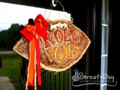 Not actually sewing, but... Here is a tutorial for those fun burlap door hangers. Looks easy enough!