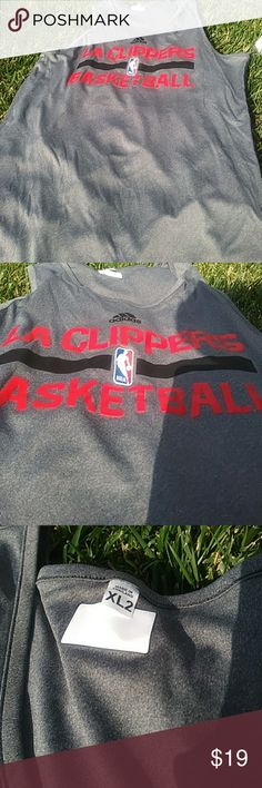 Clippers Basketball Shirt XL2 XL2 Clippers Basketball Nba Adidas Grey Sleeveless T shirt Like new but preworn  I purchased this shirt from a vintage store near the Clippers practice facility. I was told that this is not only authentic gear, but it actually belonged to the team. Simular listings available adidas Shirts Tank Tops