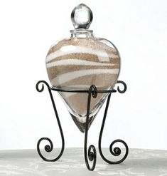 Thinking of adding a unity sand ceremony to your wedding ceremony? Then you are going to want our Heart-Shaped Wedding Unity Sand Vase and Stand. Add on as many side vases as your need: Some couples just involve themselves, while others also give a vase Unity Sand, Sand Unity Ceremony, Lillian Rose, Floating Candles, Hanging Candles, Wedding Accessories, Wedding Ideas, Wedding Stuff, Dream Wedding