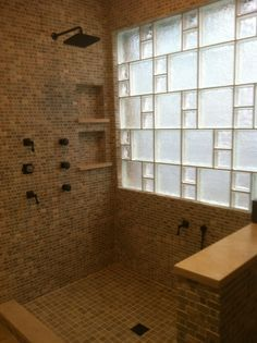 Nothing brightens up your bathroom like glass block. And when you mix the glass block sizes and patterns you create a totally custom window that adds to the unique and exclusive characteristics of your home.  Masonry & Glass Systems, Inc.