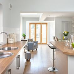 Pale grey kitchen with oak-effect floor | Kitchen decoration | Ideal Home | Housetohome.co.uk