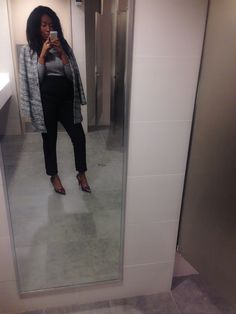 Highwaisted trousers with black and white shirt and jacket