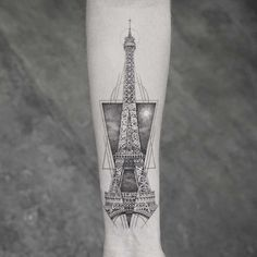 arm tattoo eiffel tower