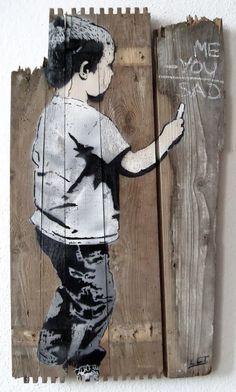 Boy drawing on fence street art