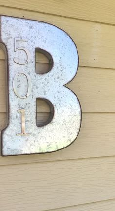 Galvanized metal letter from Hobby Lobby.  Numbers from Home Depot.