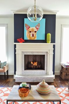 Love the focal wall bold color - dark blue.