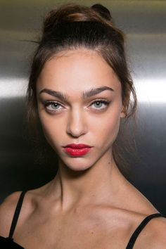 Red lipstick is classic, of course, but never have makeup artists been so united on the shade front as they were this season. See the best looks straight from the runway to inspire your look:
