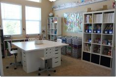 Homeschool or craft space design - love the center table. Like ideas but on a smaller scale. Large work space but also shelving with clear boxes labeled with craft items