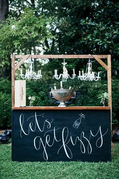 Our Homestead Chalkboard Bar looks fabulous paired with our Wooden Truss and Cut Glass Chandeliers for this Champagne Station! Brunch Wedding, Wedding Reception, Wedding Day, Diy Wedding Bar, Wedding Images, Wedding Tips, Chalkboard Bar, Birthday Chalkboard, Wilton House