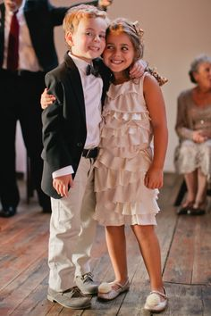 Best buds! #FlowerGirl #RingBearer | On SMP: http://www.stylemepretty.com/illinois-weddings/2013/11/12/goose-island-wedding-at-gallery-1028-from-tim-tab-studios | Photo: Tim Tab Studios
