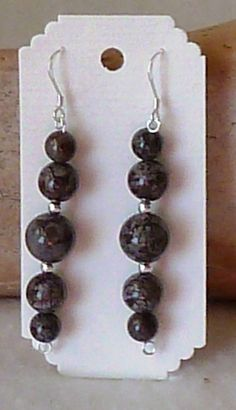Brown Snowflake Obsidian Earrings by anncarrolldesign on Etsy, $24.00  These obsidian earrings a made from natural glass occouring in lava flows. The lovely chocolate color is accented with creamy snowflake style of inclutions.  Enjoy
