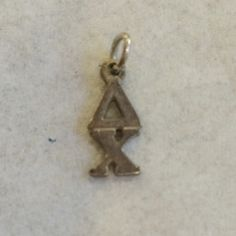 Delta Chi lavelier charm Lavalier from fraternity Delta Chi. Does need some cleaning.  Given to me in college but now graduated. Reasonable offers accepted! Jewelry