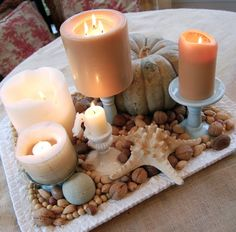"Like the mixture of ""Costal and Fall"" (pumpkin) in this lovely centerpiece."
