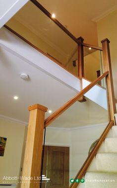 Abbott-Wade oak staircase with inline glass balustrade. example of carpeted soft… Abbott-Wade oak staircase with inline glass balustrade. example of carpeted softwood stairs, painted outside with oak posts and handrails Wooden Railing Stairs, Wood Handrail, Wooden Staircases, Stairways, Railings, Railing Design, Staircase Design, Staircase Ideas, Bespoke Staircases