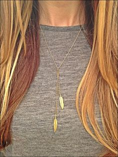 Double raw brass feather on a delicate chain lariat style necklace -Raw brass chain measures 26 inches long from top to bottom -Lobster clasp
