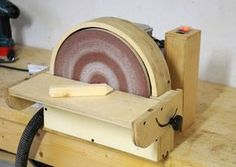 I finally finished my disk sander, and it works quite well. I bought the motor on eBay for 19€, and spent another 40€ for the rest, so total cost was 60€. I'd say it was worth it from a cost point of view.