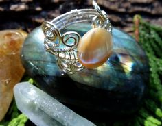 mother of pearl silver wire wrapped ring. wire wrapped jewelry handmade