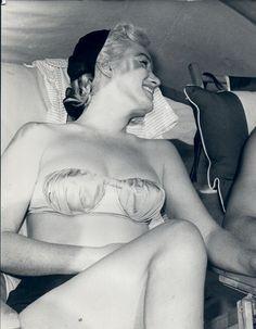 Marilyn Monroe and Joe DiMaggio  at Redington Beach, Florida, March 1961.