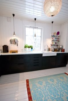 Love the white floor with the contrasting cabinets, and the farmhouse sink. I'd cook more if I had a kitchen like this.