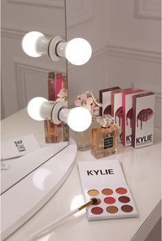 vanity mirror with a pure white finish, framed with 12 LED golf size light bulbs