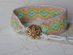 Bright blue and coraltribal woven bracelet by TowerCreationsbyTC, $30.00