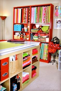 Fabric bolt storage and a cutting table. by D Walk