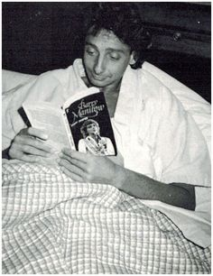 Barry Manilow in bed reading a book about himself. Interesting reading huh?