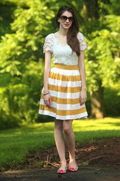 colorblock skirt in mustard with crochet top, mint tank top and floral flats