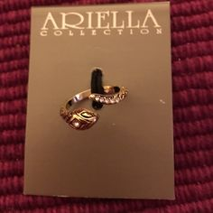 New Snake ring Brand new silver tone serpent ring with rhinestones accents. Size 8. So cute! Ariella Jewelry