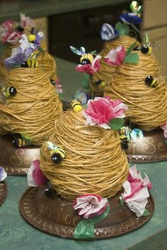 I love that craft supplies as simple as twine, tissue paper, and chenille bumblebees can be transformed into playful table decorations like these sweet bee