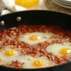 The aromatic and slightly spicy flavours of this unusual breakfast or lunch dish is delicious. It is convenient to prepare the tomato sauce portion of the dish in advance and then to add the eggs just before finishing it off. Spicy Tomato Sauce, Chickpeas, The Dish, Allrecipes, Brunch, Eggs, Dishes, Lunch Ideas, Breakfast