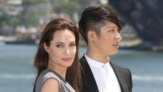 Angelina Jolie poses with Japanese musician Miyavi after the world premiere of Unbroken in Sydney, Australia. (AP)