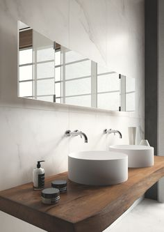"Marble bathroom with recycled timber vanity and white basin. Calacatta marble is formed through a metamorphic process which causes a complete recrystallization of calcium carbonate. The low refractive index of calcite allows light to ""penetrate"" the surface of the stone before being reflected, giving it a special brightness."