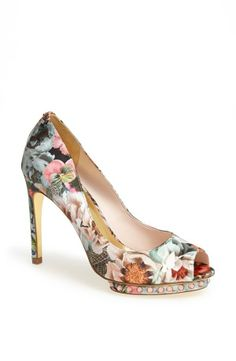 Embellished floral peep-toe pump. Perfect pop of color for a neutral outfit.
