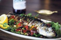 Char-grilled sardines and salsa with tomato and olives