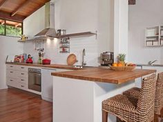 BEST? Kitchen - wooden floors and bench top; simple white cupboards; no overheads Addition - waterfall end = wood from floor to benchtop