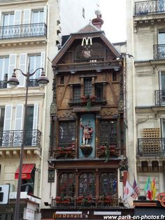 "Paris - This is the oldest McDonald's building in the world. It was installed in an old brewery called ""the King of the Beer"", which had been built in and simply kept the Bavarian frontage. Notice the stork at the top of this house: an original wind vane. Monuments, I Love Paris, France Travel, City Lights, Paris France, Francia Paris, Versailles, Architecture, The Good Place"