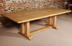 """'The Pillars' English Oak Trestle Table is one of our larger tables at approximately 9 feet in length. The Oak Trestle Table has a solid oak top 2.5"""" thick."""