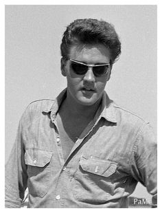 Elvis Presley summer 1961. The glasses he wore in later years looked much better on him!