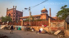 Old Delhi street near Jama Masjid mosque. Located close to the Red fort the magnificent façade of Jama Masjid stands as the reminiscence of Mughal architecture in India.  Click for more stock photos of Jama Masjid and other historical monuments.