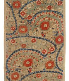 Epirus Embroidery - Embroidered linen fragment worked in silk in shades of blue, russet, green and ivory in herringbone stitch with crescent shaped leafy fronds containing round russet and ivory round flowers with more flowers filling up the rest of the field. The Epirus region, which is on mainland Greece, stayed the longest under Ottoman rule and as such reflects a strong Ottoman influence in its style. The herringbone stitch though is unique to the Epirus region.