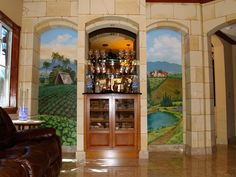 Landscape murals made for a residential bar.