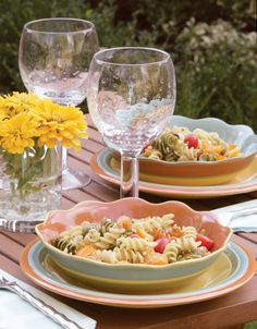 Colourful bowls and plates are perfect for summer entertaining.