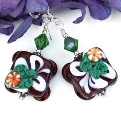 "The ""Chocolat de Noel"" handmade Christmas earrings were created with artisan petit fours lampwork glass beads, green Swarovski crystals and sterling silver."