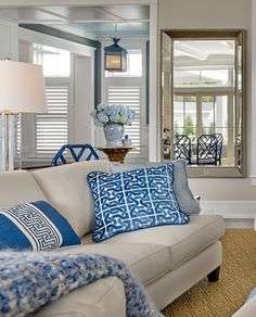 Blue and white pillows on neutral linen couch. | Asher Associates Architects. Megan Gorelick Interiors