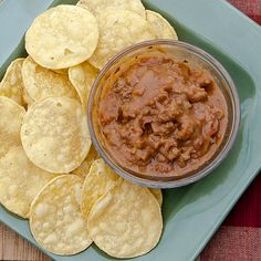 Beef and Bean Dip or Burrito Filling  Ingredients      1 lb. ground beef      1 onion, chopped      1 (16 oz) can chili beans in mild sauce      1 (14.5 oz) can petite diced tomatoes with chipotle      2 (16 oz) cans refried beans      2 cups cheddar cheese      1 tsp. cumin      1 tsp oregano      1 tsp paprika